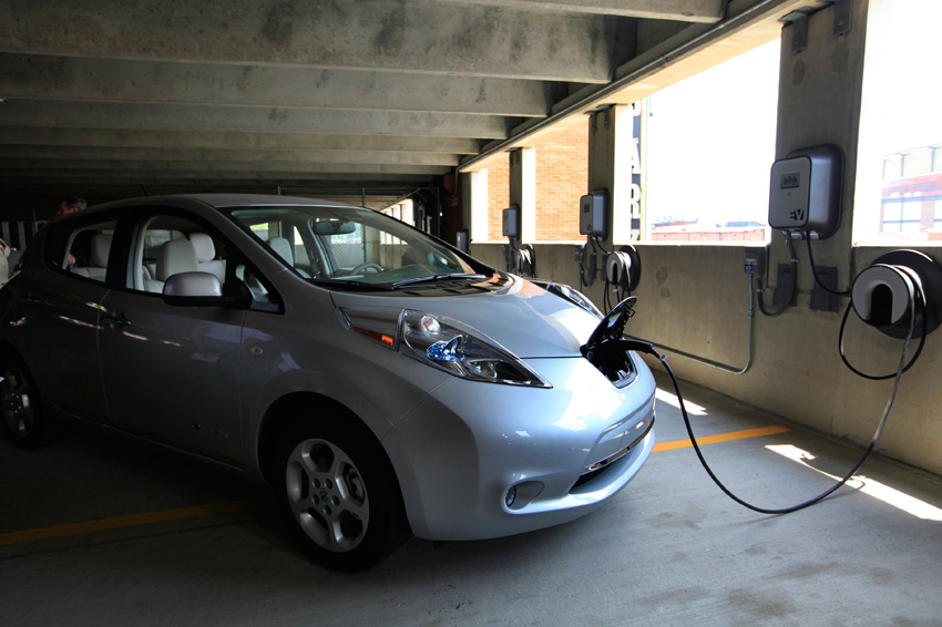 A Nissan Leaf Owned By Clint Bray Of Collierville Is Connected To A Power  Line From A Recently Installed Blink Level 2 Charging Station In The  Parking ...