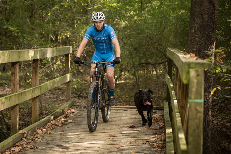 Memphis Outdoor Festival Promoter And Cycling Enthusiast Patrick Culligan Rides Through The Tour De Wolf Trail With His Dog Jack In Shelby Farms Park
