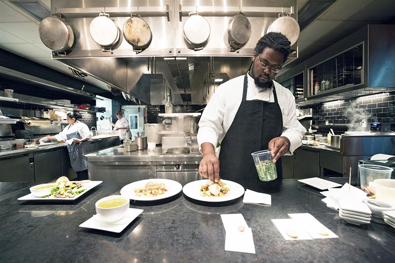 Line Chef Phillip Harris Puts Finishing Touches On Monkfish Entrees At Interim Restaurant In East Memphis Eat Here Brands Operates And Babalu