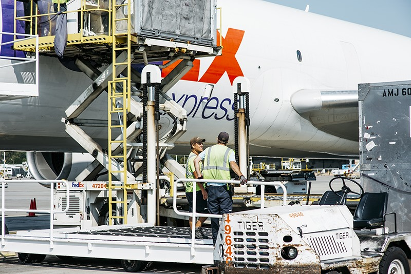 fedex employees load a md10 jet with cargo before its departure from the fedex express world hub daily newshouston cofield